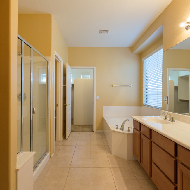 Long narrow master bathroom with master closet at end