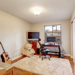 Large office room with hardwood floor.